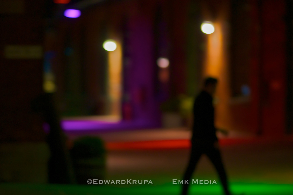 Man walking at night in the Distillery District, Toronto.
