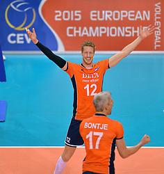 31-05-2015 NED: CEV EK Kwalificatie Nederland - Spanje, Doetinchem<br /> Nederland wint met 3-1 van Spanje en plaatst zich voor het EK in Bulgarije en Italie / Vreugde bij Kay van Dijk als 2015 European Championship een feit is