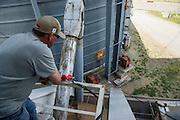 Branden Schroeder, co-owner of Schroeder Grain Company, loads a grain truck from his company elevator in El Reno, Oklahoma.