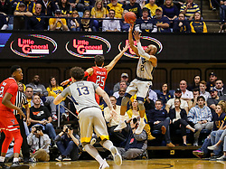 Feb 26, 2018; Morgantown, WV, USA; West Virginia Mountaineers guard Jevon Carter (2) shoots a jumper during the first half against the Texas Tech Red Raiders at WVU Coliseum. Mandatory Credit: Ben Queen-USA TODAY Sports
