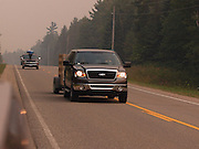 Campers and property owners evacuate the Corners area via M-407 as smoke from the Sleeper Lake fire north of Newberry in the upper pennisula intensifies.  The fire has been burning an average of 5,000 acres a day.