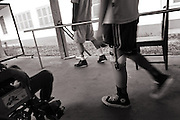 Learning to walk again at the National Rehabilitation Centre in Vientiane.