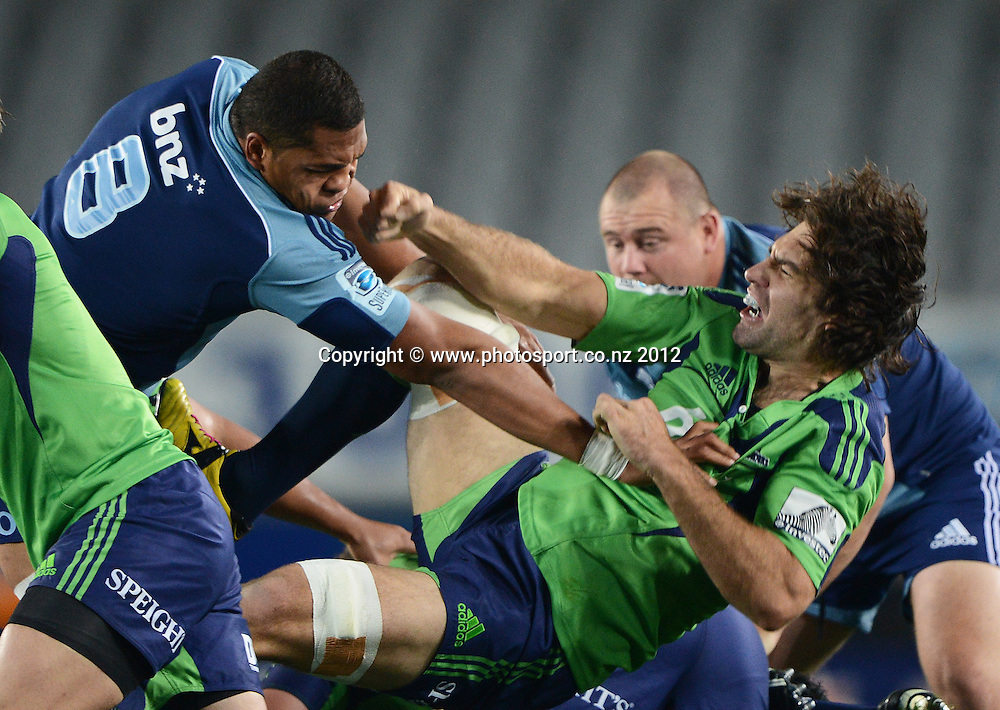 Peter Saili and Nick Crosswell fight during the Blues and Highlanders at Eden Park, Auckland, New Zealand on Saturday 26 May 2012. Photo: Andrew Cornaga/Photosport.co.nz