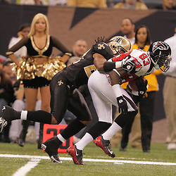 2008 December, 07: New Orleans Saints cornerback Usama Young (28) tackles Atlanta Falcons wide receiver Harry Douglas (83) during a 29-25 victory by the New Orleans Saints over NFC South divisional rivals the Atlanta Falcons at the Louisiana Superdome in New Orleans, LA.