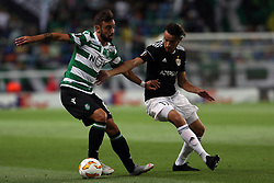 September 20, 2018 - Lisbon, Portugal - Sporting's midfielder Bruno Fernandes from Portugal (L) vies with Qarabag's midfielder Abdellah Zoubir during the UEFA Europa League Group E football match Sporting CP vs Qarabag at Alvalade stadium in Lisbon, on September 20, 2018. (Credit Image: © Pedro Fiuza/NurPhoto/ZUMA Press)