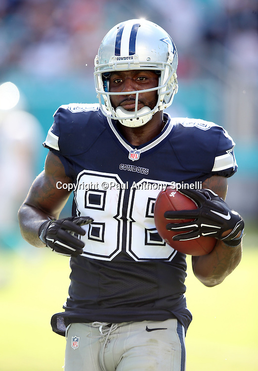 Dallas Cowboys wide receiver Dez Bryant (88) runs into the end zone untouched on a 16 yard touchdown pass that gives the Cowboys a 21-14 lead during the 2015 week 11 regular season NFL football game against the Miami Dolphins on Sunday, Nov. 22, 2015 in Miami. The Cowboys won the game 24-14. (©Paul Anthony Spinelli)