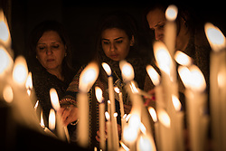 18 April 2019, Jerusalem: People light candles as on Maundy Thursday (Western tradition), the Church of Gethsemane filled to the brim with Christians from Jerusalem and all over the world participating in the Easter celebrations, who then lit candles, marching through the valley below, and up the hillside to share a moment of prayer.