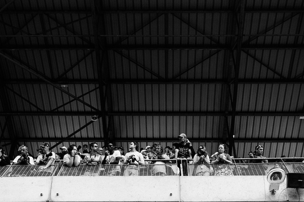 Spectators watch the end of the 2014 le Mans 24hr race. Le Mans, France, 15th June 2014. Photo by Greg Funnell.