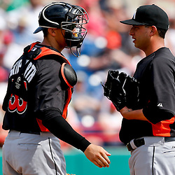 Mar 9, 2013; Melbourne, FL, USA; Miami Marlins pitcher Alex Sanabia talks with catcher Kyle Skipworth (53) at the mound during the bottom of the second inning of a spring training game against the Washington Nationals at Space Coast Stadium. Mandatory Credit: Derick E. Hingle-USA TODAY Sports