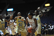 """Ole Miss forward Shequila Joseph (11) vs. \s40\ and Southern University Jaguars forward/center Jasmine Jefferson (15) at the C.M. """"Tad"""" Smith Coliseum in Oxford, Miss. on Thursday, November 20, 2014. (AP Photo/Oxford Eagle, Bruce Newman)"""