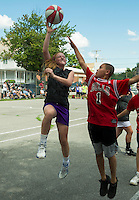 "Cheyanne Zappala on the ""Work Hard Play Hard"" team goes up for a shot against Jake Estevez on the ""Bulls"" team during the Bob Dearborn 3 on 3 Memorial Basketball Tournament at Wyatt Park Saturday.  (Karen Bobotas/for the Laconia Daily Sun)"