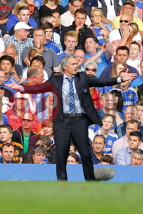 Chelsea Manager, Jose Mourinho reacts  - Photo mandatory by-line: Mitchell Gunn/JMP - Tel: Mobile: 07966 386802 18/08/2013 - SPORT - FOOTBALL - Stamford Bridge - London -  Chelsea v Hull City - Barclays Premier League