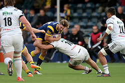 Andy Short of Worcester Warriors is challenged by Thomas Acquier of Brive - Mandatory by-line: Dougie Allward/JMP - 22/10/2016 - RUGBY - Sixways Stadium - Worcester, England - Worcester Warriors v Brive - European Challenge Cup