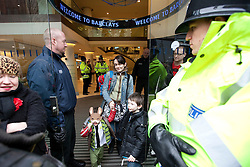 © under license to London News Pictures. 19/02/2011: UKUncut protester Eve Steele and children occupied Barclays Bank on Market Street in Manchester City Centre. Their occupation and protest outside forced the closure of the branch. Protesters say that Barclays Bank pays large bonuses whilst legally avoiding a large percentage of tax. Eve Steele played Anne Malone in Coronation Street and has also appeared in Spooks, Peak Practice and Casualty.