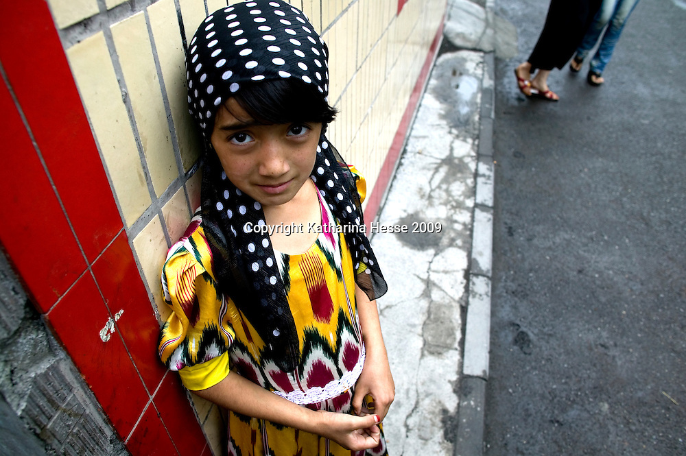 URUMQI, JULY-15 : a little Uighur girl in the Xiangyang Po district, a poor quarter of the city dominated by Uighurs, Turkic-speaking Muslims who have often had an uneasy relationship with China's Han majority. Uighurs are the largest ethnic group in Xinjiang, but in Urumqi, Han make up more than 70 percent of the 2.3 million residents.<br /> Many Han Chinese were killed in Xiangyang Po during the protests in early July 2009.