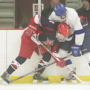 Wilmington's Alexei Kouminov challenges Grennsboro's Ethan Solomita Sunday December 21, 2014 at The Ice House in Wilmington, N.C. (Jason A. Frizzelle)