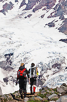Two climbers heading up Mt Rainier in Washington State, USA.
