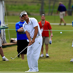 2009 April 26: Daniel Chopra of Falun, Sweden chips onto the green at the seventh hole during the final round of the Zurich Classic of New Orleans PGA Tour golf tournament played at TPC Louisiana in Avondale, Louisiana.
