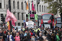 © Licensed to London News Pictures. 07/10/2019. London, UK. Extinction Rebellion protestors block Trafalgar Square in central London . Activists are converging on Westminster blockading roads in the area for at least two weeks calling on government departments to 'Tell the Truth' about what they are doing to tackle the Emergency. Photo credit: Peter Macdiarmid/LNP