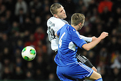 15.10.2013, Kassel, GER, UEFA U21 EM Qualifikation, Deutschland vs Faroer Inseln, Gruppe 6, 8. Runde, im Bild Kopfballduell, re Hoffmann (Deutschl, U21, Hannover 96) (hinten), Hordur Askham (Faroer Isl, s U21), Aktion, Action // during the UEFA U21 European Championship group six 8th round qualifier between Germany and Faroe Islands at the Kassel, Germany on 2013/10/15. EXPA Pictures © 2013, PhotoCredit: EXPA/ Eibner-Pressefoto/ Sippel<br /> <br /> *****ATTENTION - OUT of GER*****