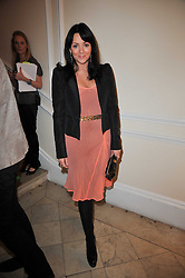 MARTINE McCUTCHEON at a photographic retrospective showcasing images from Guess's historic advertising campaigns held at Il Bottaccio, Grosvenor Place, London on 28th October 2009.