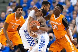 Kentucky guard Tyler Ulis, center runs into traffic while rolling off a pick from forward Skal Labissiere in the first half.<br /> <br /> The University of Kentucky hosted the University of Tennessee, Thursday, Feb. 18, 2016 at Rupp Arena in Lexington.