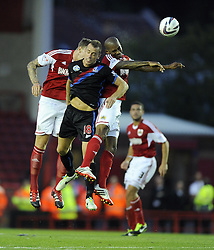 Bristol City's Marvin Elliott and Bristol City's Aden Flint  battles for the high ball with Crystal Palace's Aaron Wilbraham  - Photo mandatory by-line: Joe Meredith/JMP - Tel: Mobile: 07966 386802 27/08/2013 - SPORT - FOOTBALL - Ashton Gate - Bristol - Bristol City V Crystal Palace -  Capital One Cup - Round 2