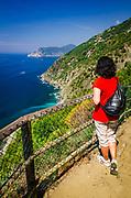 Woman on the Sentiero Azzurro (Blue Trail) near Vernazza, Cinque Terre, Liguria, Italy