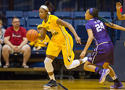 West Virginia Mountaineers guard Bria Holmes (23) grabs a rebound and drives up the court against the TCU Horned Frogs at the WVU Coliseum.