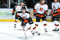 KELOWNA, CANADA, OCTOBER 11:  Matthew Konan #6 of the Medicine Hat Tigers skates with the puck during warm-up as the Medicine Hat Tigers visited the Kelowna Rockets on October 11, 2011 at Prospera Place in Kelowna, British Columbia, Canada (Photo by Marissa Baecker/shootthebreeze.ca) *** Local Caption ***Matthew Konan;
