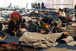 Licensed to London News Pictures. 03/11/2015. Sentilj, Slovenia. Migrants and refugees camp in Sentilj, Slovenia at the border crossing Slovenia - Austra. Photo: Marko Vanovsek/LNP