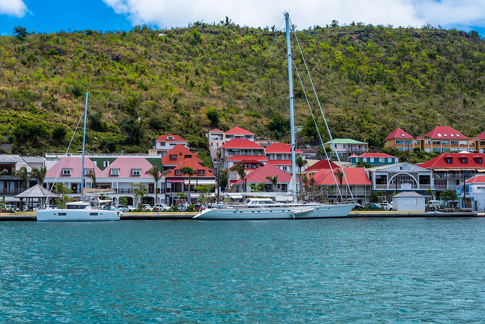 Gustavia, St Barths-- April 25, 2018. Yachts  in Gustavia harbor with the town and mountain in the background. Editorial Use Only.