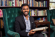 Environmental portrait of Mervin Jebaraj for Notable Neighbors in the library of his home, on November 12, 2015, in Fayetteville, Arkansas. Photo by Beth Hall