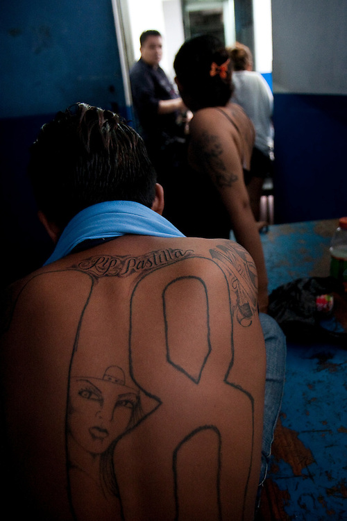 Luis Martinez Armas  (front) waits to be transferred to a jail for minors at the Ilopango Police station in San Salvador.  He joined when he was 13.  Many gangs recruit  youths from the dilapidated public schools of El Salvador. In the past these children were from poor and broken families, increasingly they are coming from stable an d middle class families because of intense peer pressure.