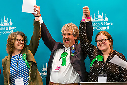 © Licensed to London News Pictures. 03/05/2019. Brighton, UK. Members of the Green Party (L-R) SIRIOL HUGH-JONES, LEO LITTMAN and AMY HELEY are elected to the Brighton and Hove council taking all seats in the Preston Park ward previously held by the Labour Party. Photo credit: Hugo Michiels/LNP
