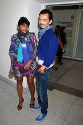 DEVIKA DASS and MATTHEW WILLIAMSON at a reception hosted by Vogue magazine to launch photographer Tim Walker's book 'Pictures' sponsored by Nude, held at The Design Museum, Shad Thames, London SE1 on 8th May 2008.<br />