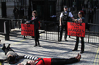 Block the Bankers Budget Protest Downing Street entrance , London, UK, 23 March 2011:  Contact: Rich@Piqtured.com +44(0)7941 079620 (Picture by Richard Goldschmidt)