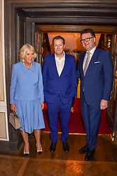 HRH The Duchess of Cornwall, her son Tom Parker Bowles and Ewan Venters Chief Executive Officer of Fortnum & Mason at the launch of the Fortnum & Mason Christmas & Other Winter Feasts Cook Book by Tom Parker Bowles held at Fortnum & Mason, 181 Piccadilly, London, England. 17 October 2018.