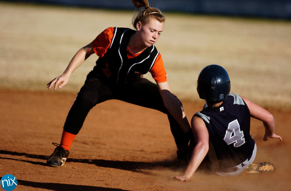 Hickory Ridge's Emma Stevenson slides safely into second base  as Northwest Cabarrus' Andrea Jones tries to tag her out. Hickory Ridge won the game 3-0.