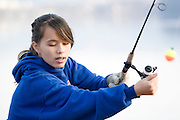 Minnesota USA, Winona A young female teen Fishing in the Mississippi river  November 2006