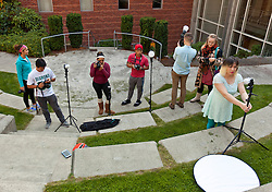 Photo students working on a flash photo assignment using the amphitheater at MBR on Tuesday, Sept. 29, 2015. (Photo/John Froschauer)