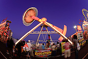 "Oct 14, 2008 -- PHOENIX, AZ: The ""Evolution"" ride at the Arizona State Fair. The Arizona State Fair started Oct.  10 and runs through Nov. 2. Carnival and midway workers who have worked the fair for years say attendance so far is much lower than in the past and people at the fair this year aren't spending as much money as they have in the past. Photo by Jack Kurtz / ZUMA Press"