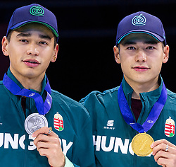 12-01-2019 NED: ISU European Short Track Championships 2019 day 2, Dordrecht<br /> (L-R) Shaolin Sandor Liu and Shaoang Liu of Hungary pose in the Men's 500m medal ceremony during the ISU European Short Track Speed Skating Championships