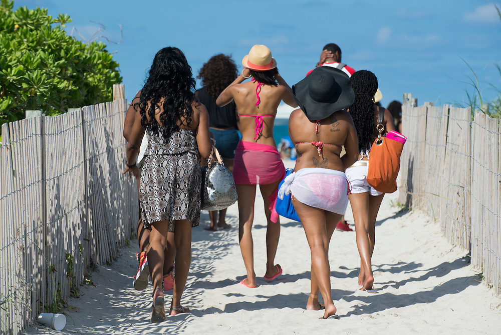 MIAMI - May 26, 2012: People walking to the beach during the Miami Beach Urban Weekend, this is the largest Urban Festival in the World, that caters towards the Hip Hop Generation. Over 300.000 participants make the annual trek to South Beach for 4 days full of fun, food, festivities, entertainment, music, and more.