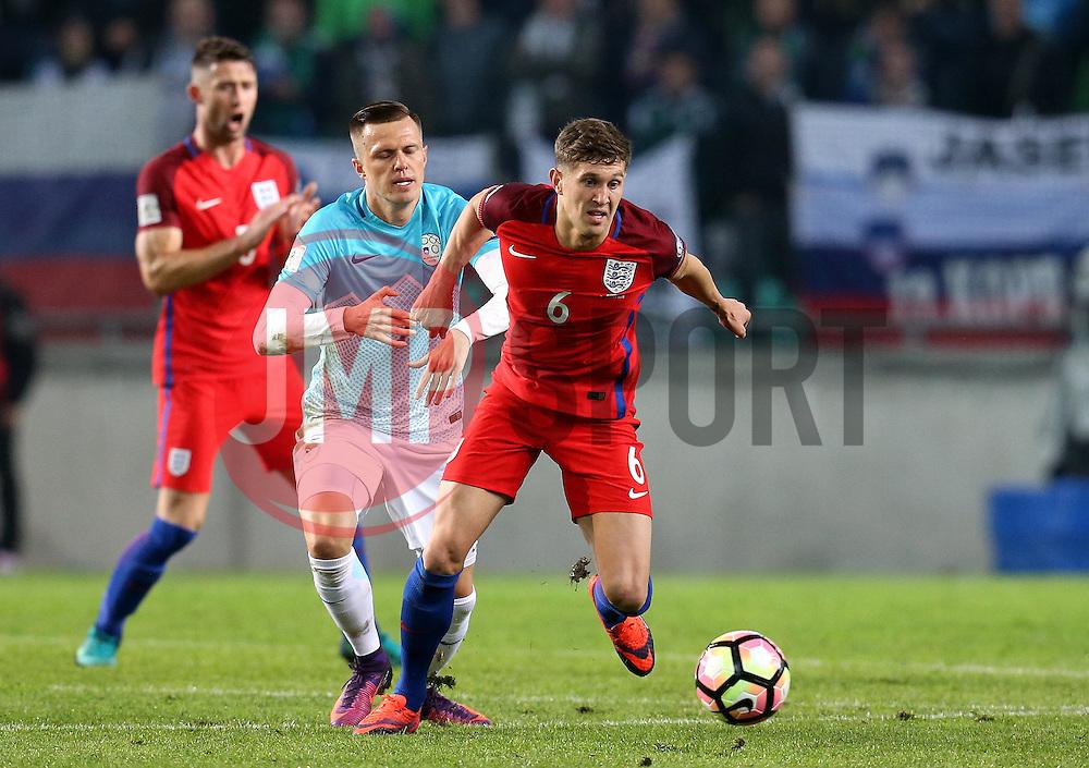John Stones of England goes past Josip Illicic of Slovenia - Mandatory by-line: Robbie Stephenson/JMP - 11/10/2016 - FOOTBALL - RSC Stozice - Ljubljana, England - Slovenia v England - World Cup European Qualifier