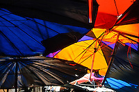 Umbrellas used to create shade at a street market in Bangkok, Thailand