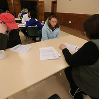 Kimberly Kaufman, 23, answers a few questions at Tuesday's All Saints Saint Brew as part of a survey of the homeless population.