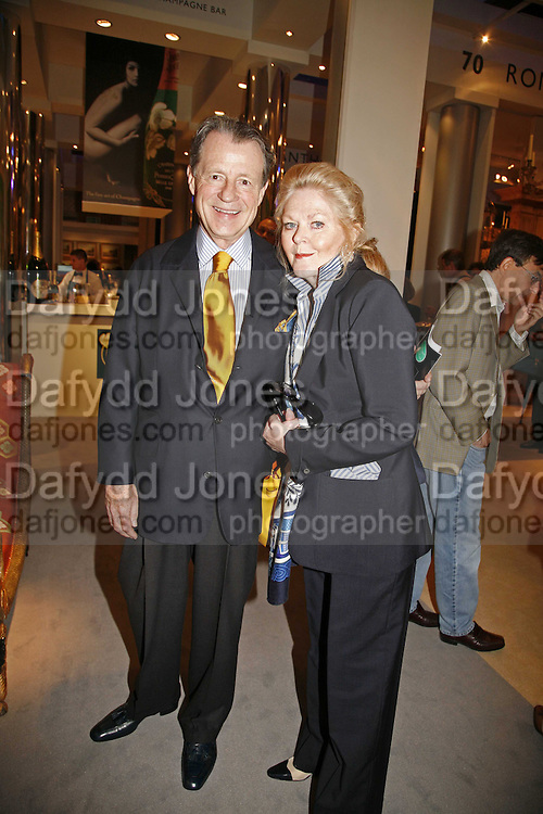 Mr. and Mrs. Leo A. Daly, ( from Washington). The opening  day of the Grosvenor House Art and Antiques Fair.  Grosvenor House. Park Lane. London. 14 June 2006. ONE TIME USE ONLY - DO NOT ARCHIVE  © Copyright Photograph by Dafydd Jones 66 Stockwell Park Rd. London SW9 0DA Tel 020 7733 0108 www.dafjones.com