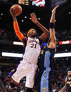 Mar. 10, 2011; Phoenix, AZ, USA; Phoenix Suns forward Hakim Warrick (21) puts up a shot against the Denver Nuggets forward Kenyon Martin (4) at the US Airways Center. The Nuggets defeated the Suns 116-97. Mandatory Credit: Jennifer Stewart-US PRESSWIRE