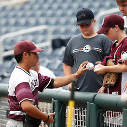 Jun 25, 2013; Omaha, NE, USA; Mississippi State Bulldogs pitcher/outfielder Luis Pollorena (22) signs autographs for fans before game 2 of the College World Series finals against the UCLA Bruins at TD Ameritrade Park. Mandatory Credit: Derick E. Hingle-USA TODAY Sports